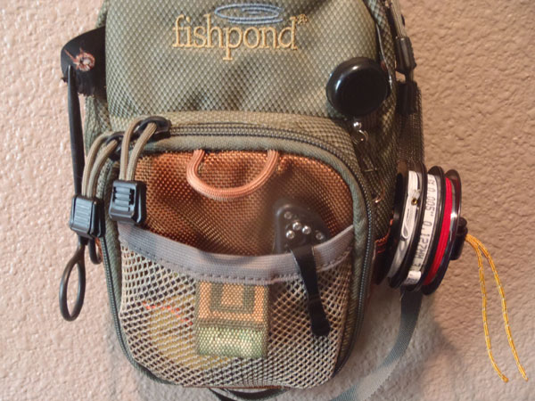 DIY tippet spool holder on a chest pack