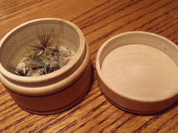 Round bamboo fly box open