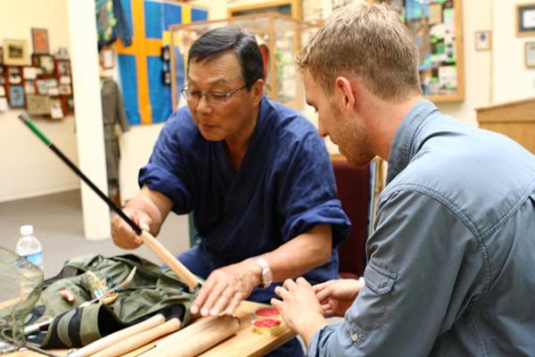 Dr. Ishigaki inspecting a Tenkara USA rod