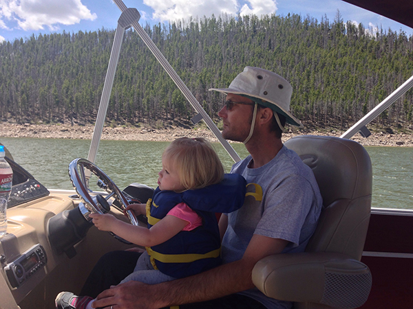 YAY! Emma is driving a boat!